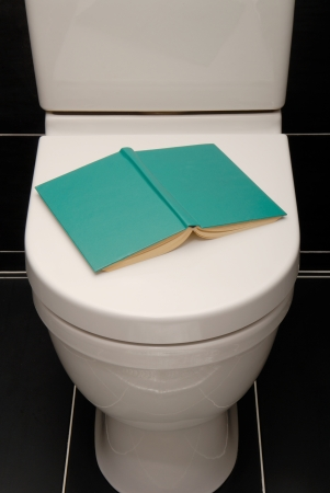 w c: There is a book on a toilet pan