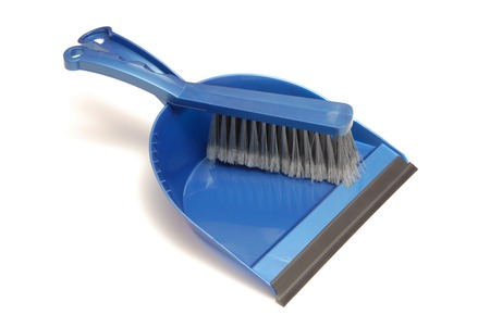 Blue dustpan and broom are on white background