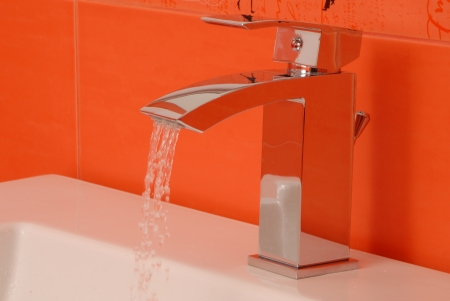 chromium plated: Modern chromium-plated  mixer tap in bathroom