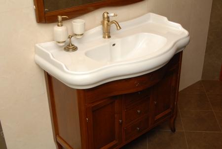pedestal sink: wash sink is in  interior of bathroom