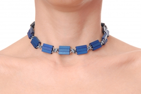 blue plastic necklace on female neck