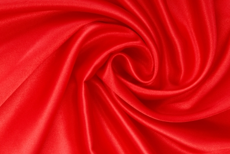 pleat: It is a red  silk fabric  Stock Photo