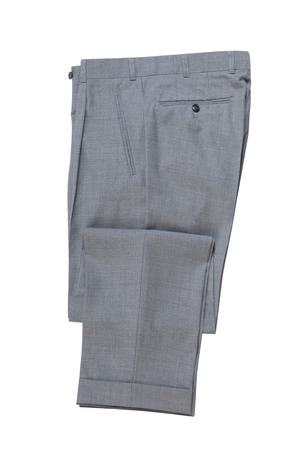 mens folded grey classical trousers.  photo