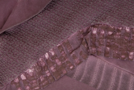 a close-up of  dress with combined textiles photo