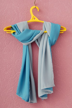 double-sided silk scarf on yellow coat-hanger photo