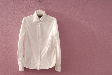 chemise: White chemise is on hanger  Stock Photo