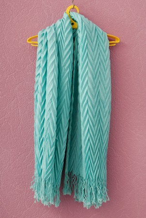 pleated: pleated scarf is on yellow hanger Stock Photo