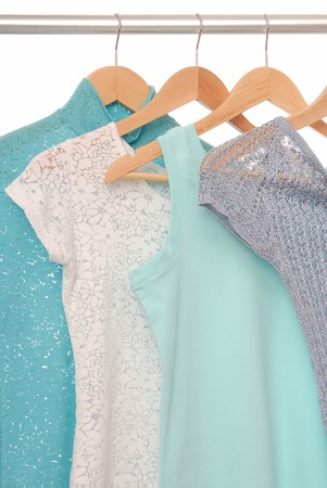 Summery blouses are on coat-hangers  photo