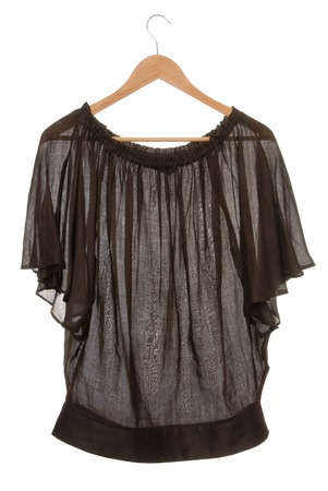 clotheshanger: Wide brown blouse is on clothes-hanger