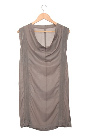 Grey tunic is on  clothes-hanger  photo