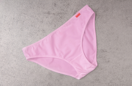 swimming trunks: pink swimming trunks is on grey Stock Photo