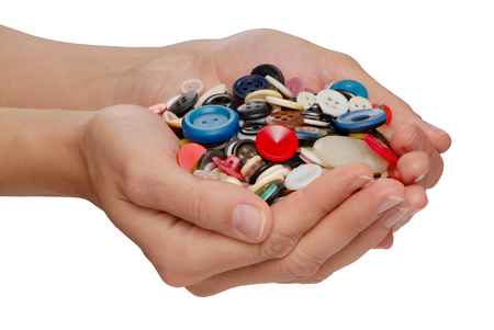 plastik: different buttons in female hands Stock Photo