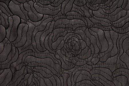imitation leather: black imitation leather with embroidery Stock Photo