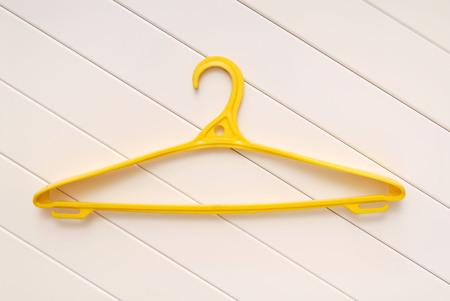 hangers: yellow hangers for clothes