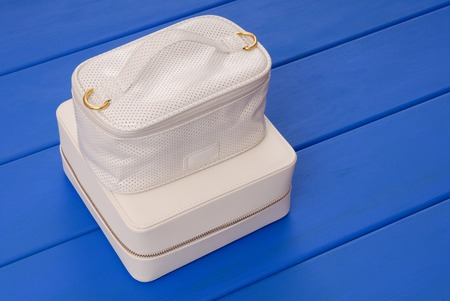couple of white leather boxes with cosmetic