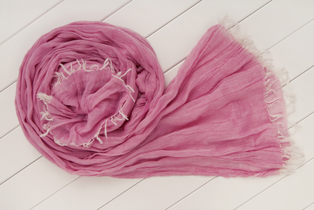 twisted  purple scarf is on white show-case
