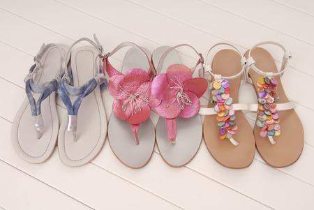 footwear: three couple of leather flip flops, assortment, footwear, sandals Stock Photo