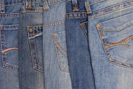 denim background: pile of jeans, blue denim background