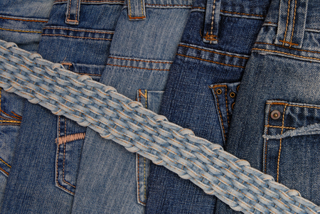 braided: different blue  jeans and braided belt Stock Photo