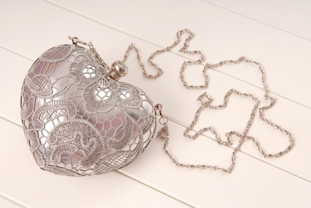 metal evening handbag with chain, clutch has heart shape