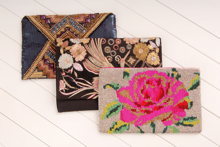 three handbags with embroidery, clutchs of envelope shape