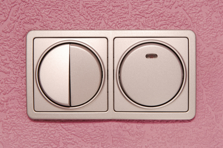 grey switch is on the  lilac wall, home interior