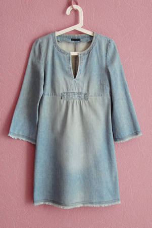 clotheshanger: blue denim dress, jeans wear Stock Photo