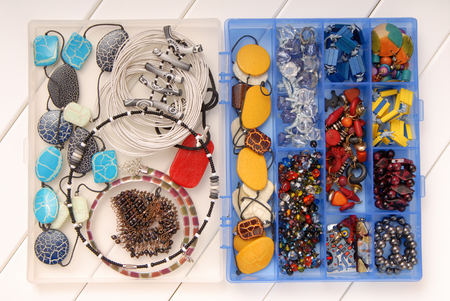 assortment of female accessories, bijouterie is in box, beads, earrings and  necklace Stock Photo