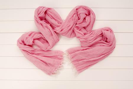 fashionable pink scarf is on white background, showcase, Stock Photo