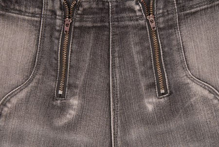 grey denim backgrounds, close up of jeans, fashionable trousers