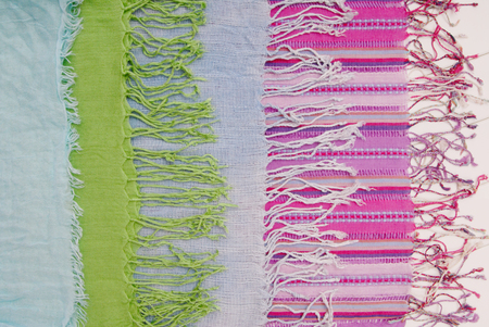 combination: assortment of scarfs with fringe,  accessories are on shop window Stock Photo