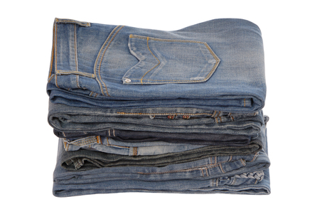isolated heap of blue jeans, a pile of jeans-wear is on white