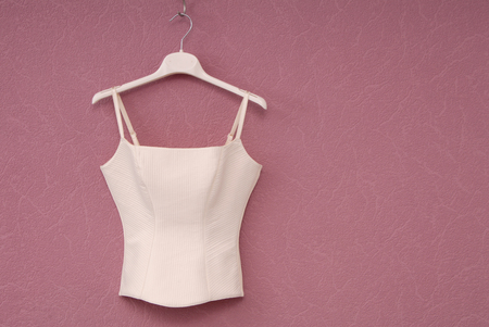 white corset, wedding corset, white bodice is on the lilack background, beautiful top,