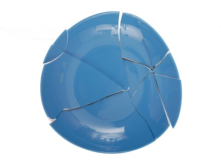 shiver: blue broken plate, simbol of crisis, splinters of dish, tableware, splinters of plate Stock Photo