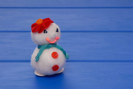 female snowman on  New Years post card, snowmans on Christmas card, handmade snowmans,  syntepon New-Year tree decorations, New Years creative background Stock Photo