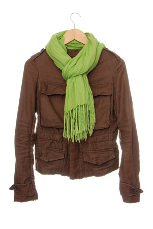 brown jacket is isolated and light gree scarf with fringe, beauty and fashion, informal casual clothes