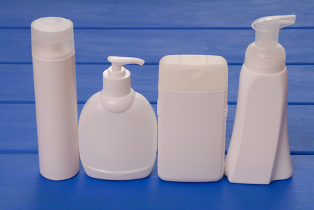 four vials of cosmetics, cosmetic bottles, assortment of cosmetic flasks, health and beauty
