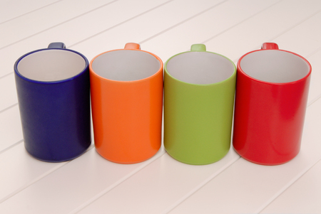 a set of mugs, assortment of colorful cups, red, green, blue, orange mugs
