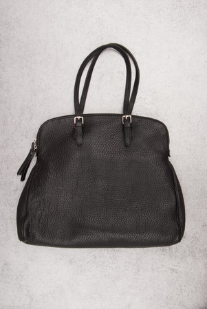 black handbag, leather handbag is on grey background, female big handbag