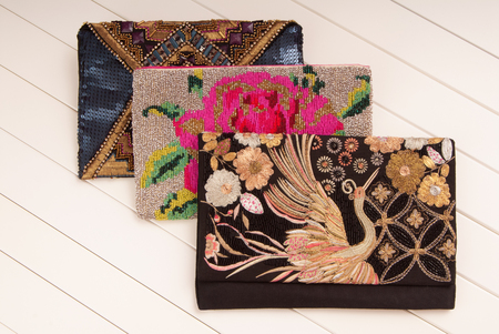 embroidered handbags, three handbags with embroidery, clutches of envelope shape, black clutch, fashionable clutches