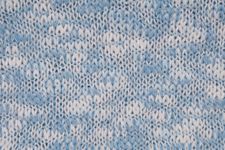 knitted background, light blue and white colour, crocheted backdrop Stock Photo
