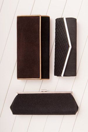 assortment of clutchs, elegance black handbags, black and brown klatch, evening handbags, black clutches