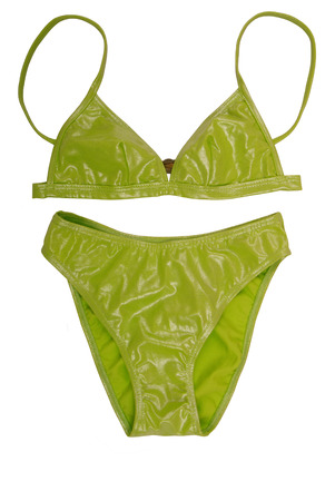 It is light green bathing suit. The female bathing suit is on white background. Isolated shine swimsuit as a single object. A beautiful  bathing suit has bright colour.