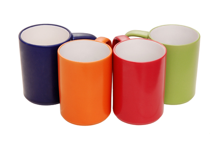 set of mugs green, orange, blue, red,  multicoloured cups, assortment of many-coloured mugs, isolated cups are on white, tea mugs