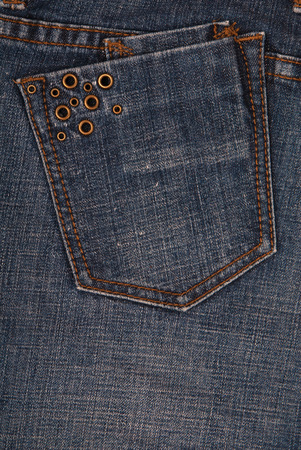 vertical denim background,  denim textures, blue jeans backgrounds, close up of jeans with button, fashionable trousers, blue jeans, blue jeans backdrops, back pocket, rivets are on hip pocket Stock Photo