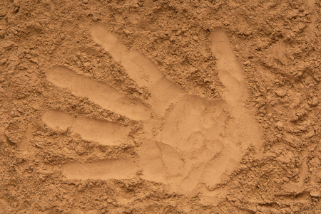 textured backgrounds is out of sand, closeup of ground, yellow sand, surface of earth, creative background, pattern of palm, trace of hand, hand impression, imprint of hand, trace of hand