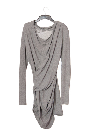 asymmetrical model of female garment, asymmetric grey blouse, gray cotton tunic is on white baground, isolated blouse is as single object, extravagant clothes, draped long sleeve shirt, eccentric shirt-dress  is on hanger