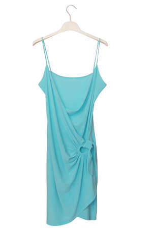 summer dress is on white clothes-hanger, light blue evening frock, asymmetrical female frock
