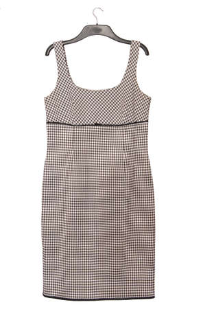 gray pinafore dress with checkered pattern, black and white gown is as single object, isolated wollen frock on clothes-hanger, gray business checkered outfit Imagens