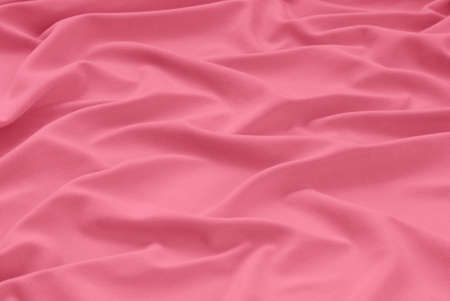 textile pink background, rosy cloth as creative backdrop, draped bright material, abstract drape